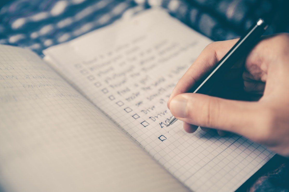 hand writing checklist in <span class='ent _notebook'>notebook</span> best online business to start