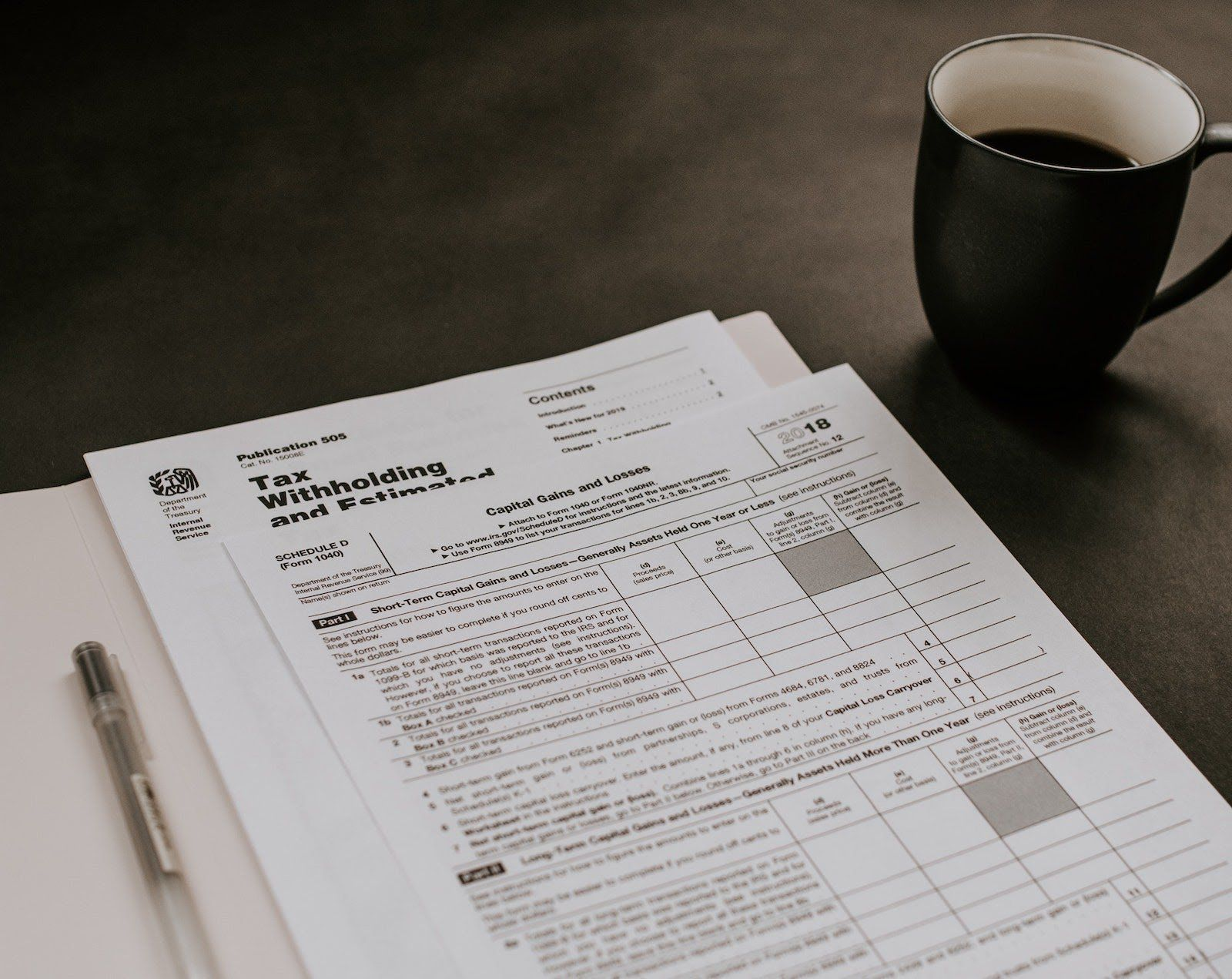 contract vs full time tax papers and coffee